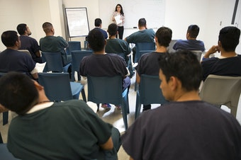 Virginia Cole, with the Northwest Immigrant Rights Project, teaches a legal aid class at the Northwest Detention Center on Wednesday, June 21, 2017, in Tacoma.
