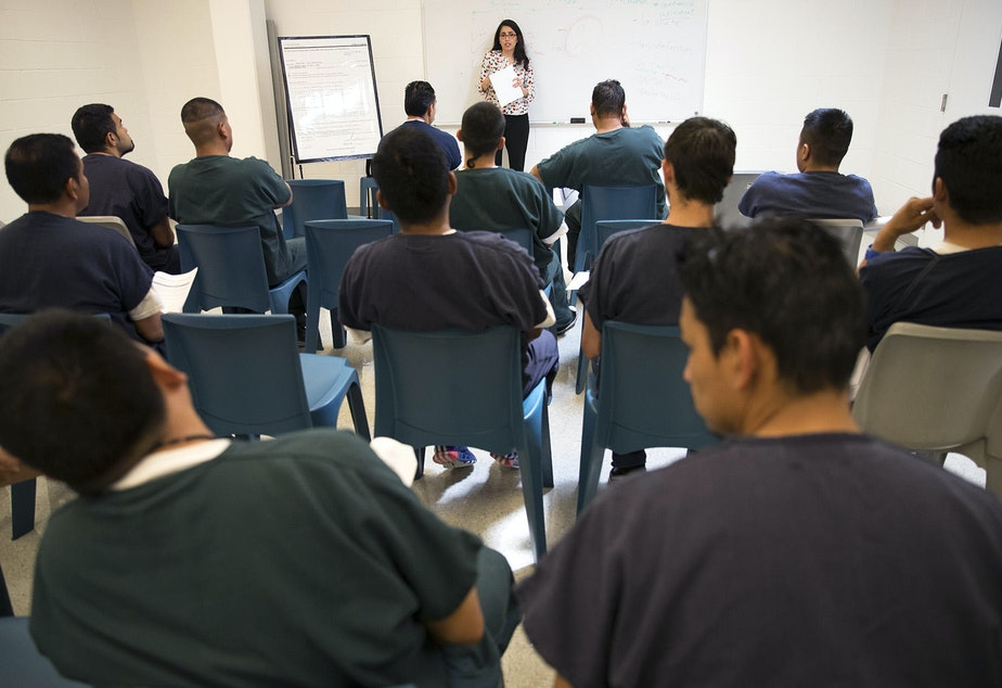 caption: Virginia Cole, with the Northwest Immigrant Rights Project, teaches a legal aid class at the Northwest Detention Center on Wednesday, June 21, 2017, in Tacoma.