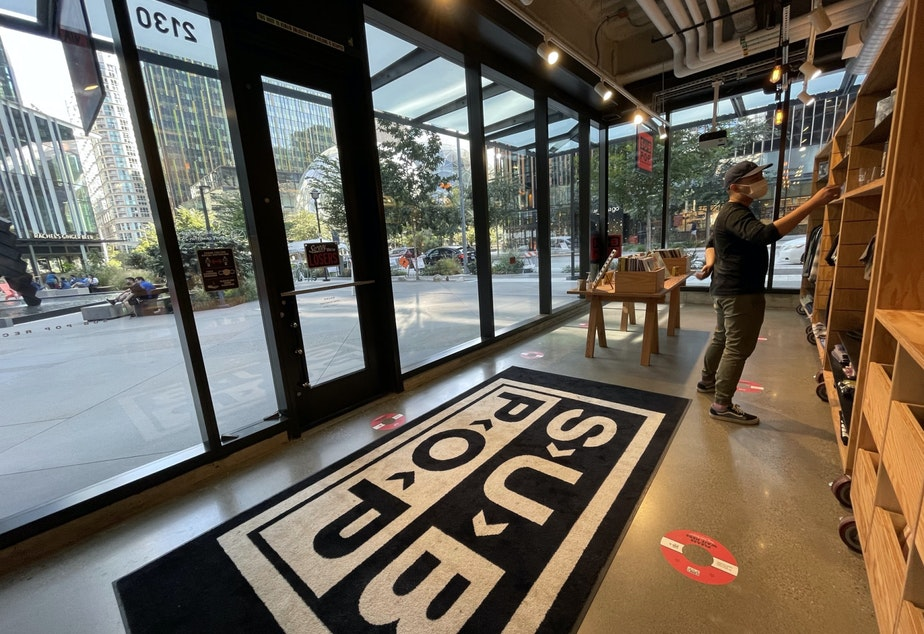 caption: A customer browses in Subpop's pop-up store on Amazon's campus
