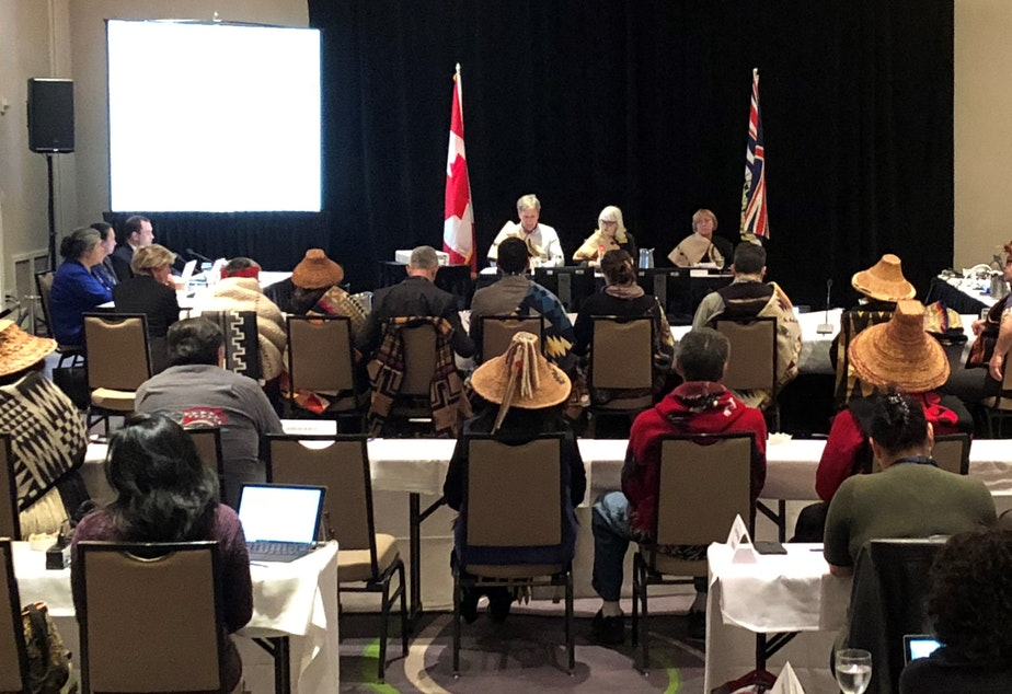 "caption: Traditional cedar hats abound as Washington tribal leaders speak at an ""oral traditional evidence"" hearing held by the National Energy Board in Victoria, B.C."