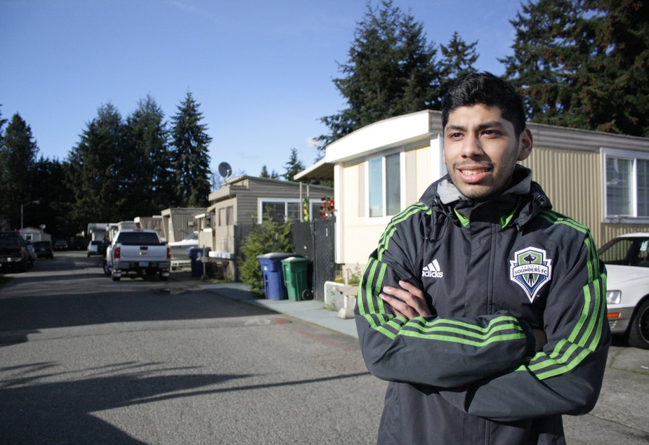 caption: Jeremy Chirinos of Renton was in middle school when Jimi Hendrix's house arrived. The failure of a museum project that would have surrounded the house meant he had an affordable place to grow up.