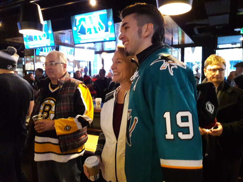 caption: Mayor Jenny Durkan with hockey fans at Henry's Tavern on Tuesday, December 4, 2018. She announced to the crowd that Seattle had been awarded a hockey team from the NHL.