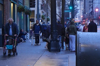 Crowds of homeless people often gather on the sidewalks of downtown Seattle near social-service providers.