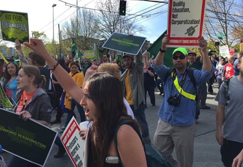 caption: Protesters rally as part of the National Day of Action for Higher Wages on Capitol Hill, Seattle, on April 15, 2015.