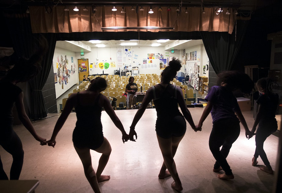 Baile Dior Studios dance instructor, TiQuida Spellman, center, watches the dancers during practice on Thursday, May 10, 2018, at Rainier Beach high school in Seattle.