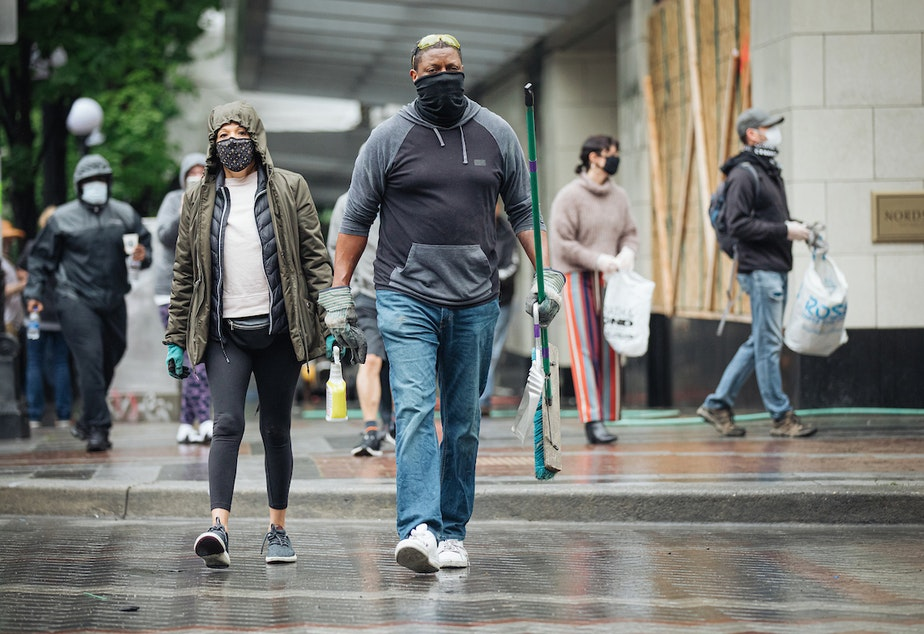 caption: Seattle photographer Joshua Trujillo went downtown on Sunday morning to capture scenes of people cleaning up after the protests on Saturday night.