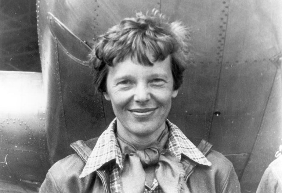 caption: File photo of Amelia Earhart beneath the nose of her Lockheed Model 10 Electra in Oakland, California, in March 1937.