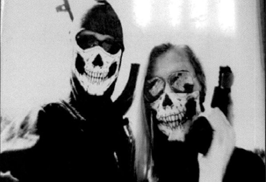 Law enforcement officials say they obtained this image from Kaleb Cole's cell phone. Cole appears on the left. Police say he is a self-proclaimed member of a neo-Nazi group called Atomwaffen Division.