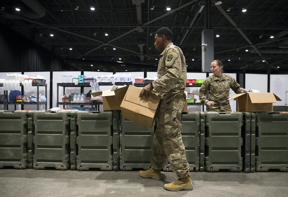caption: U.S. Army soldiers store medical equipment near the ICU area of the military field hospital inside CenturyLink Field Event Center on Sunday, April 5, 2020, in Seattle. The 250-bed hospital for non COVID-19 patients was deployed by U.S. Army soldiers from the 627th Army Hospital from Fort Carson, Colorado, as well as soldiers from Joint Base Lewis-McChord.