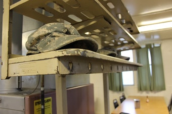 FILE: Soldiers place their hats on rack just inside the mess hall doors before eating breakfast at Joint Base Lewis-McChord in January 2015.