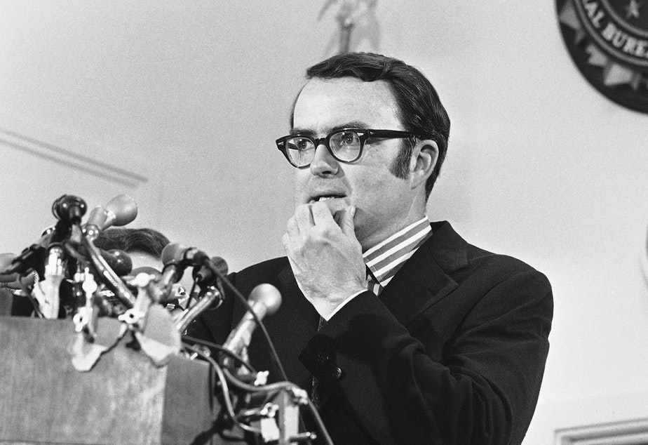 caption: Then-acting FBI Director William D. Ruckelshaus pauses during a May 1973 news conference in Washington, D.C. Ruckelshaus died Wednesday at the age of 87.