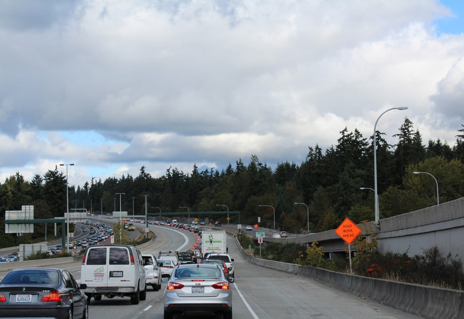 caption: Earlier this fall, I-405 was reduced to two lanes in order to allow crews to complete final striping for the new express toll lanes. After opening, they're still causing consternation for some drivers.