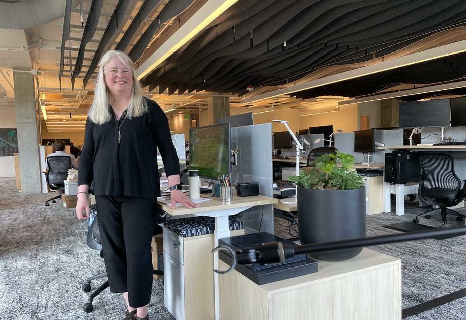 caption: Kristen Scott in the new Watershed offices.