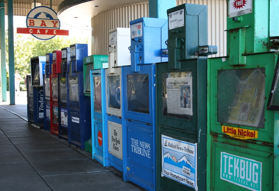 A row of newspaper dispensers in Seattle.