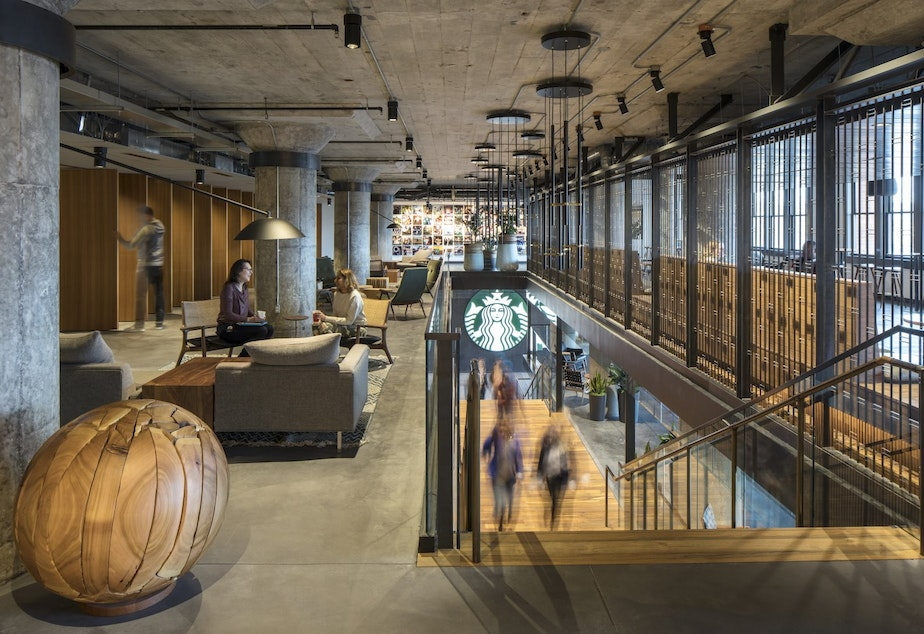 caption: A Starbucks spokesperson says after the HQ redesign, more of its work spaces will look like this, with casual spaces to gather rather than private desks.
