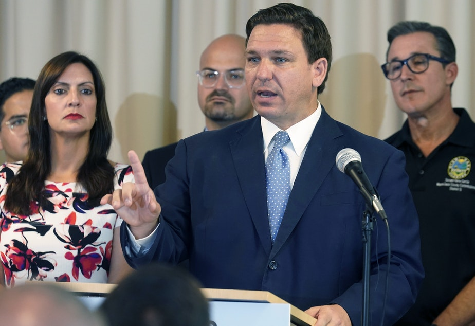 """caption: Florida's new """"anti-riot"""" law championed by Republican Gov. Ron DeSantis as a way to quell violent protests is unconstitutional and cannot be enforced, a federal judge ruled Thursday."""