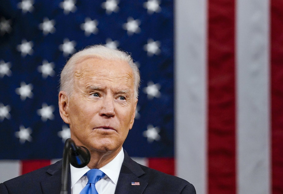 caption: President Biden proposed expanding the role of government in universal pre-K and free community college.