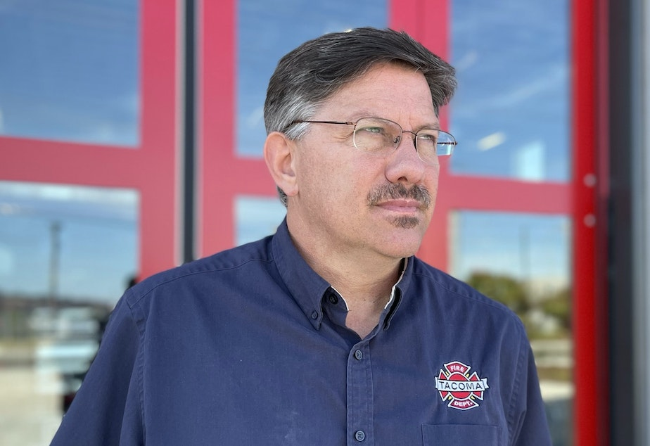 caption: Joe Meinecke is a spokesperson for the Tacoma Fire Department. He stands outside of Fire Station 5, near Firecracker Alley.