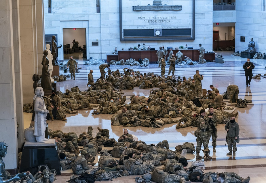 caption: Hundreds of National Guard troops hold inside the Capitol Visitor's Center to reinforce security at the Capitol in Washington.