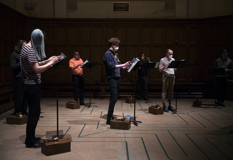 caption: Members of the Compline Choir rehearse while wearing masks ahead of a live-streamed Easter service on Sunday, April 12, 2020, at St. Mark's Episcopal Cathedral in the Capitol Hill neighborhood of Seattle.