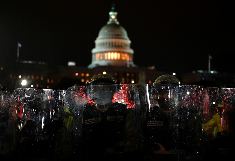 caption: Members of the D.C. National Guard are deployed outside of the U.S. Capitol on Wednesday evening. Supporters of President Trump stormed a session of Congress earlier Wednesday.