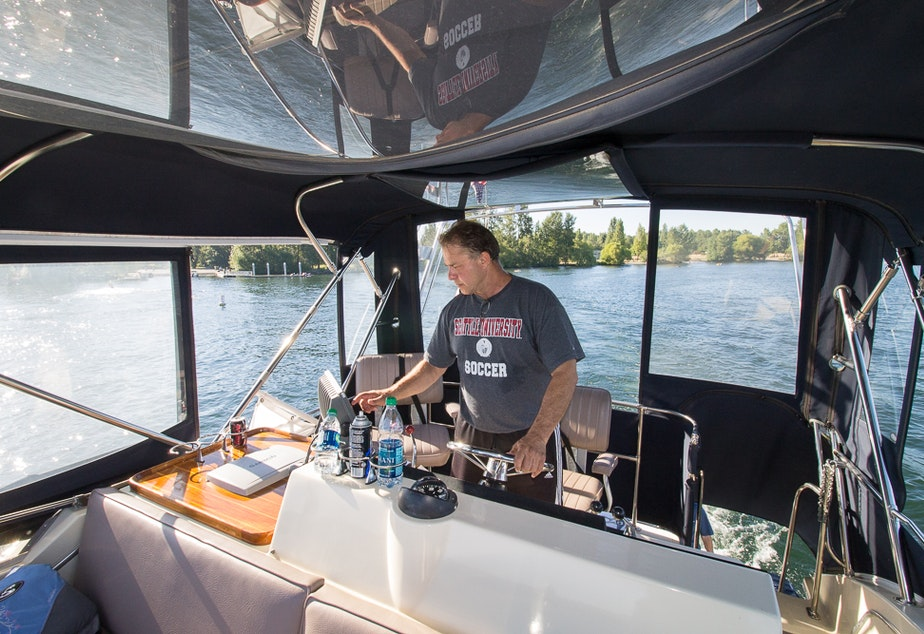 "caption: ""Nobody takes out the trash on the bottom of Lake Washington,"" says Mike Racine, captain of ""Hat Trick."""