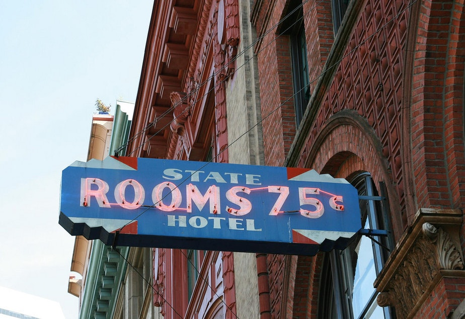 caption: A 1960s sign from an old flophouse in Pioneer Square in Seattle.
