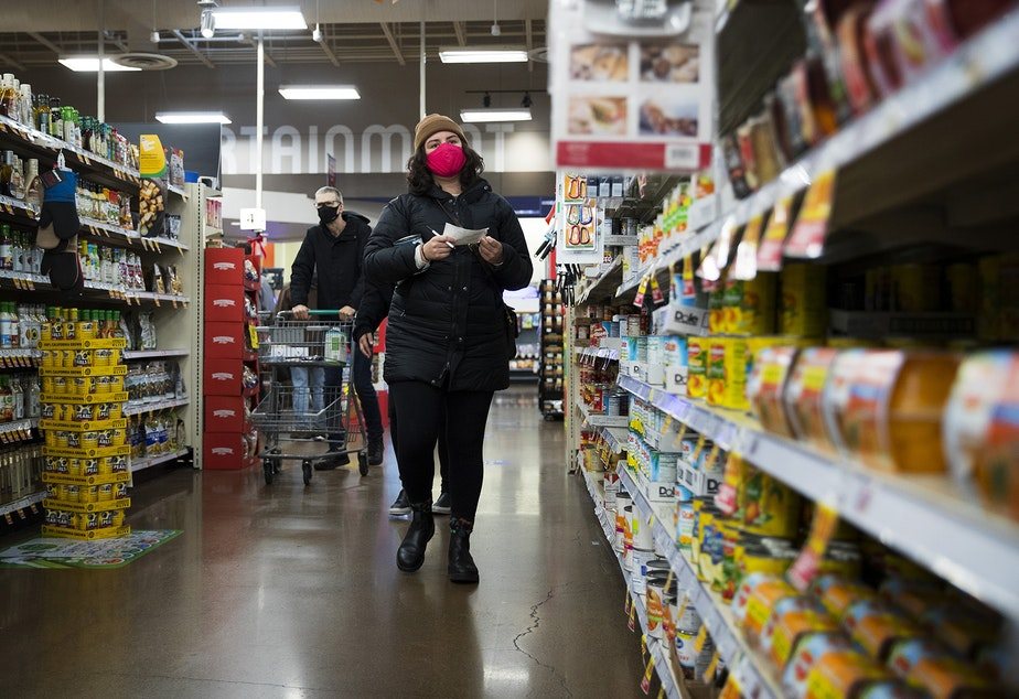 caption: Melissa grocery shops at Fred Meyer on Monday, November 16, 2020, on Northwest 45th Street in Seattle. New statewide restrictions were announced by Gov. Jay Inslee on Sunday to curb the rapid spread of Covid-19.
