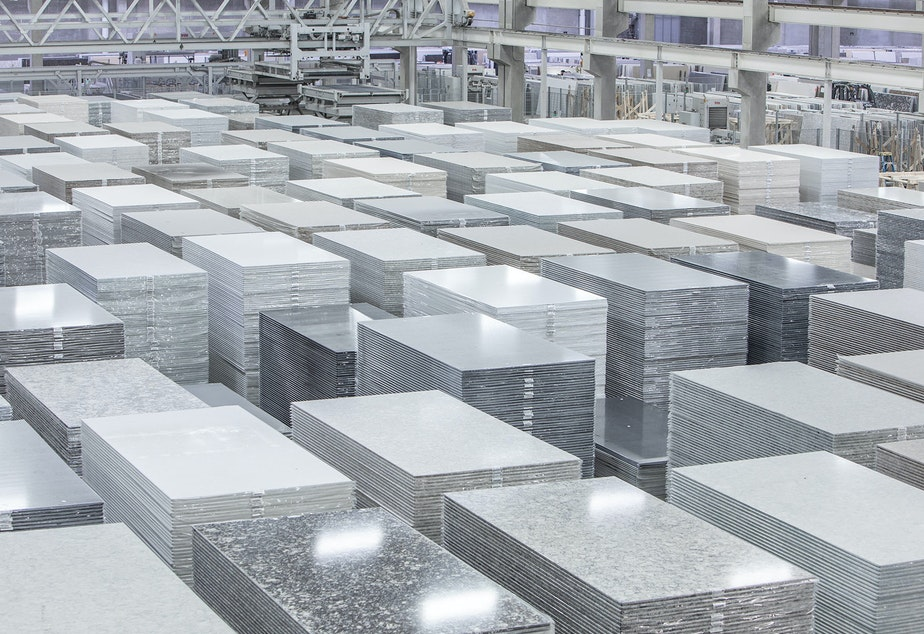 caption: The Cambria factory in Minnesota manufactures slabs of engineered quartz for kitchen and bathroom countertops. If businesses don't follow worker protection rules, cutting these slabs to fit customers'<strong> </strong>kitchens can release lung-damaging silica dust.