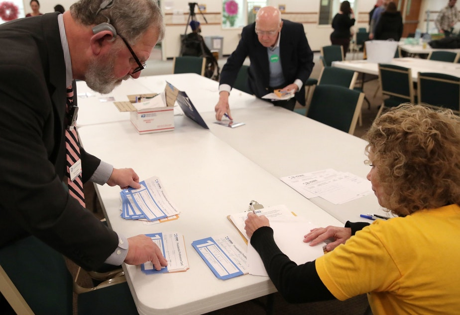Presidential preference cards are counted at a caucus at West Des Moines Christian Church in Iowa on Monday. Problems with a smartphone app designed to report the caucus results ended up delaying an official count.