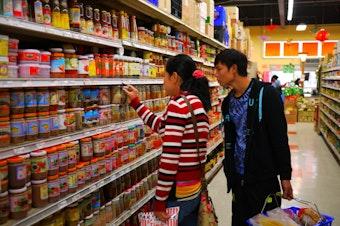 Burmese refugee Tu Tu goes on his first shopping trip in the U.S.