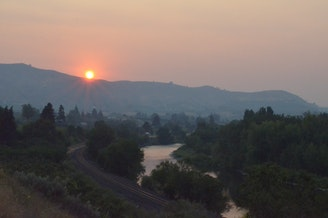 Wildfire smoke blankets the Wenatchee area at sunset recently.