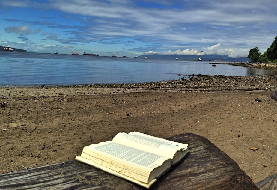 A book spoted on a log in English Bay
