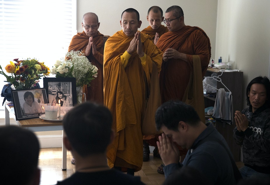 A dedication ceremony with the Buddhangkura Buddhist Temple of Washington takes place in the apartment of Kornkamon Leenawarat, 25, and Thiti-on Chotechuangsab, 32, on Wednesday, September 12, 2018, at the Malloy Apartments in Seattle.