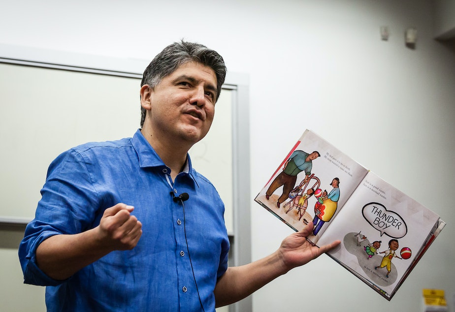 caption: File: Sherman Alexie reads from his book, 'Thunder Boy Jr.,' at the RED INK Indigenous Initiative for All at Arizona State University, Tempe, April 22, 2016.