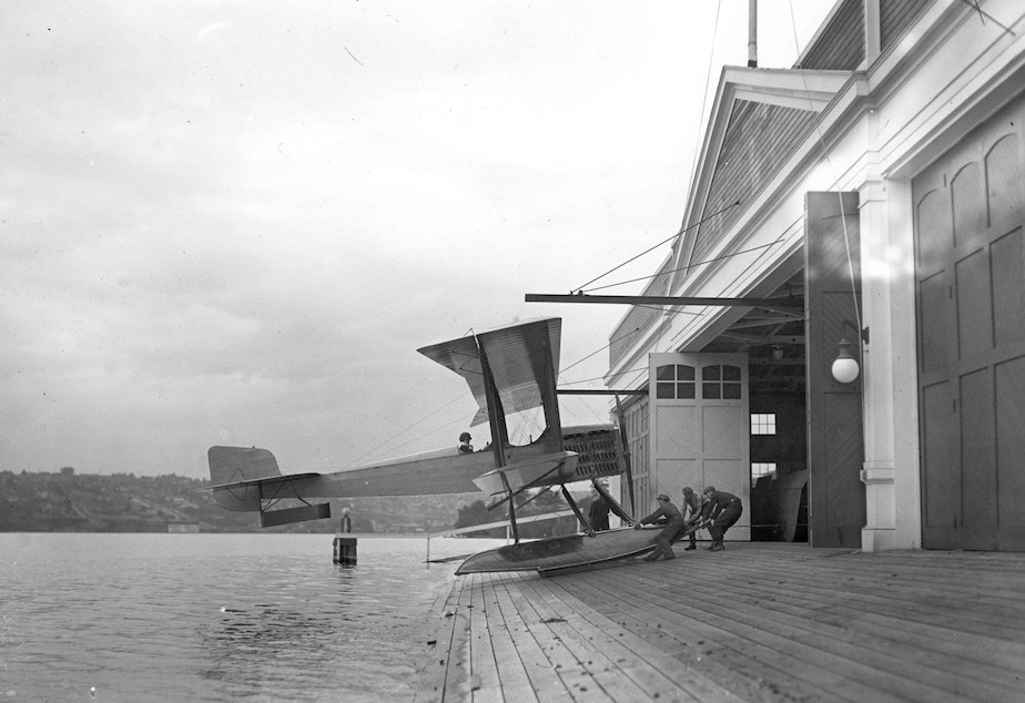 caption: The first Boeing airplane, the Bluebill, B&W Model 1, assembled and launched from Seattle's Lake Union