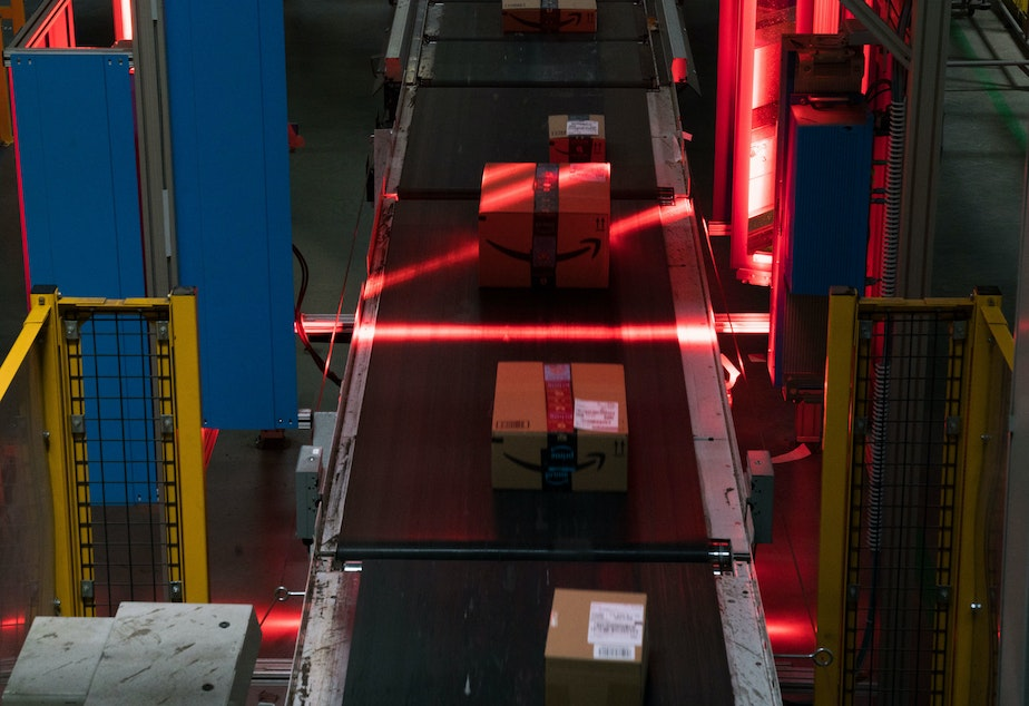 Amazon boxes are scanned on conveyor belts. AI systems keep track of all items in the warehouses, which can be as vast as 1 million square feet.
