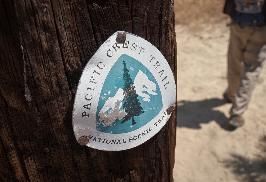 A trail marker designating the Pacific Crest Trail.