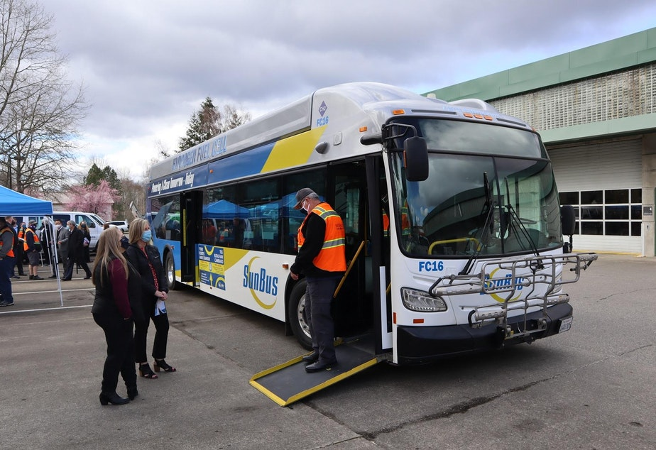 caption: A hydrogen fuel cell electric bus on loan from SunLine Transit in Palm Springs was displayed at the Intercity Transit bus barn in Olympia on March 25.