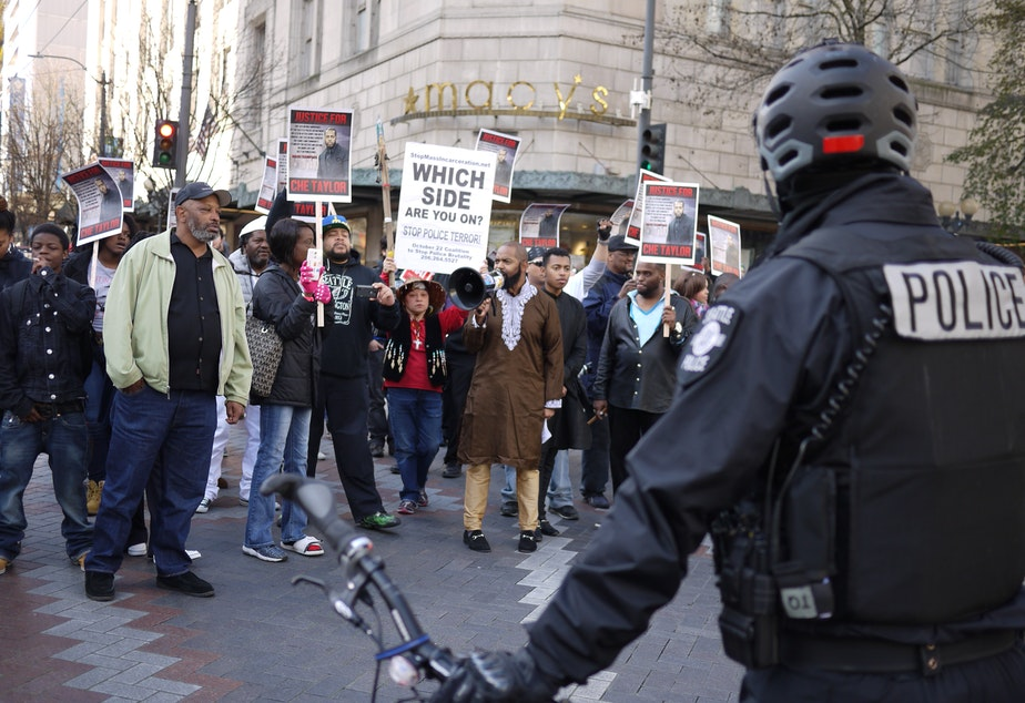 caption: A march protesting the Seattle police shooting of Che Taylor on Feb. 21 moves through downtown Seattle on Feb. 25.