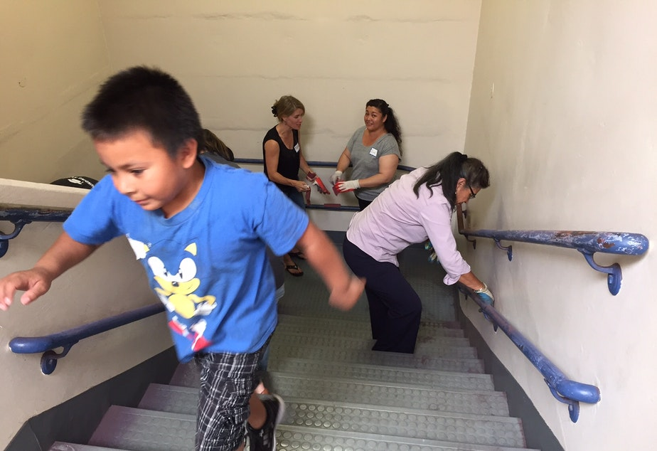 Families at Rainier Prep, a charter school, at a work party last summer. The state supreme court ruled charter schools are unconstitutional as this school year started.