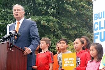 Gov. Jay Inslee speaks outside Seattle's Lawton Elementary School on Aug. 16.