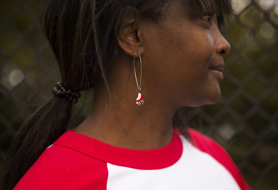caption: Tiffany Mason, founder of Roll Around Seatown, stands for a portrait wearing roller-skate earrings on Tuesday, September 22, 2020, at the Judkins Park sports court in Seattle.