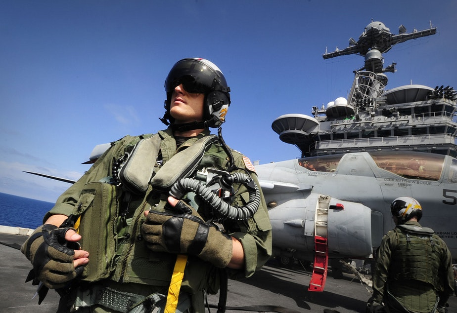 caption: Lt. Roy Walker, from the Electronic Attack Squadron (VAQ) on the flight deck of the aircraft carrier USS John C. Stennis.