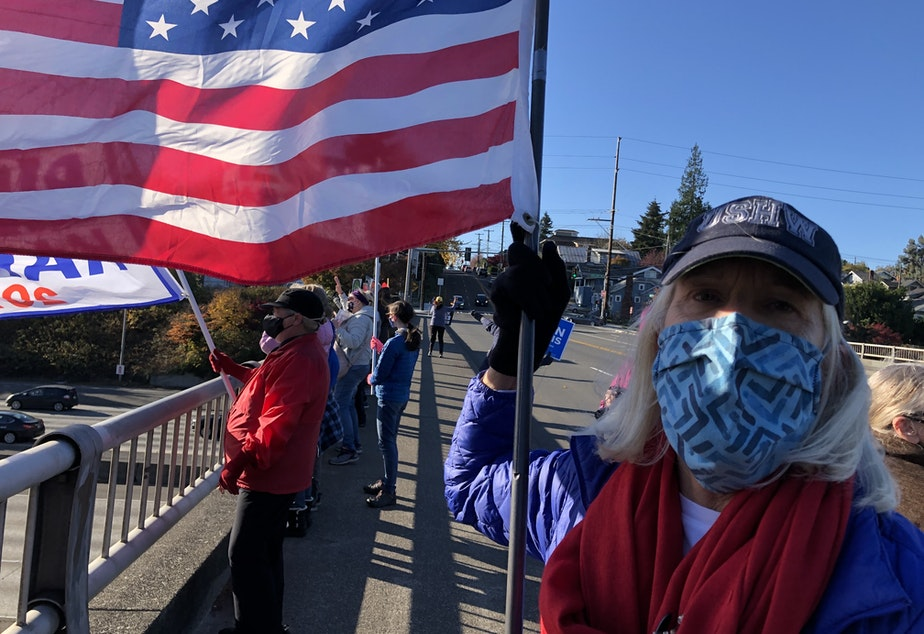 caption: An Anti-Trump group waved flags over I-5 in Seattle on Nov. 8, 2020.