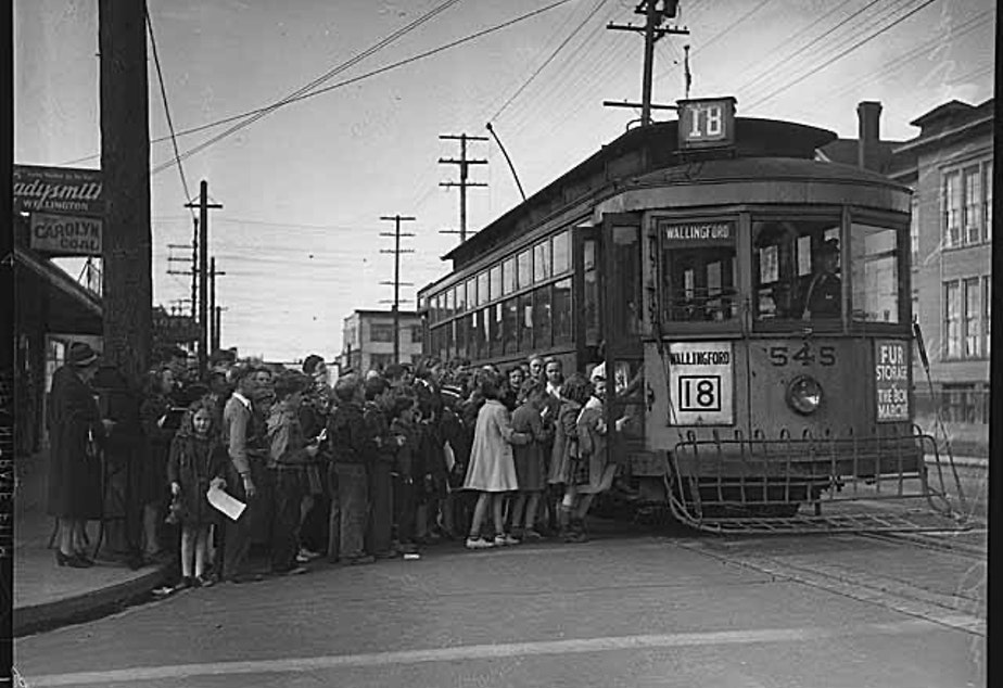 caption: The Wallingford streetcar line connected downtown Seattle with the outlying areas of Wallingford and the University District. In May 1940, the streetcars stopped running and were replaced by buses.
