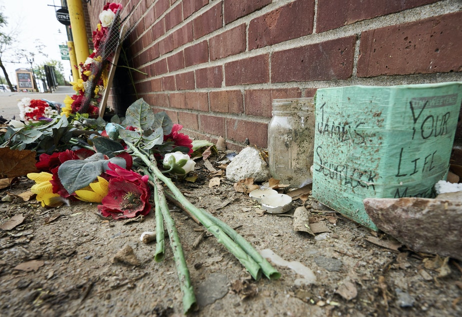 caption: The site of James Scurlock's shooting death in Omaha, Neb., is still being preserved as a memorial in mid-September. On Tuesday, a grand jury indicted Jake Gardner in the killing, handing down four charges including manslaughter.