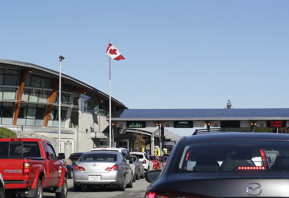 caption: Traffic enters Canada from the United States at the Peace Arch Border Crossing in Blaine, Wash., in 2019. Vaccinated Americans will be able to travel to Canada, starting Aug. 9.
