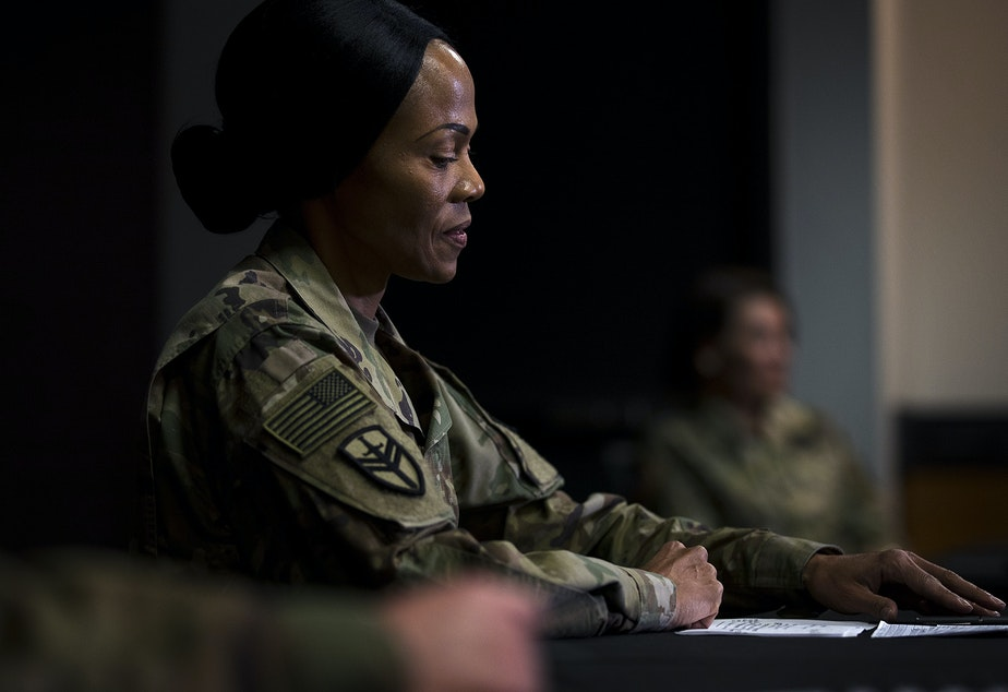 caption: Col. Hope Williamson-Younce, Commander of the 627th Hospital Center in Fort Carson, Colorado, attends a press conference at the 250-bed military field hospital for non COVID-19 patients deployed at the CenturyLink Field Event Center on Sunday, April 5, 2020, in Seattle.