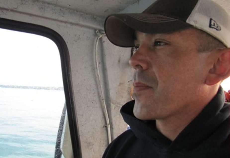 Jay Julius is a Lummi tribal council member and fisherman. He cites the Pacific International Terminals' non-permitted actions at Cherry Point as a source of tribal opposition to the Gateway Pacific Terminal.